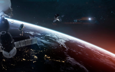 Wall Mural - Look on our planet from orbit and astronauts at the spacewalk. Elements of this image furnished by NASA