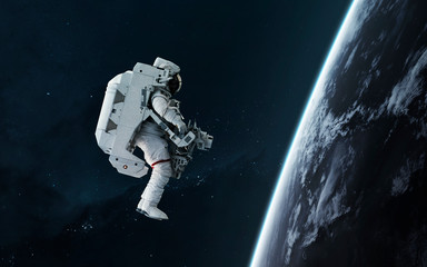 Wall Mural - Astronaut orbitin Earth planet, EVA, science fiction image. Elements of this image furnished by NASA