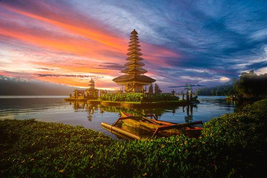 Pura Ulun Danu Bratan, Hindu temple with boat on Bratan lake landscape at sunset in Bali, Indonesia.
