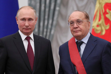 Russian President Putin and Rector of the Lomonosov Moscow State University Sadovnichy attend an awarding ceremony in Moscow