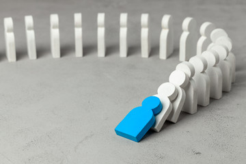 Domino effect in business. One businessman leader falls and brings down other figures of employees. System disruption.