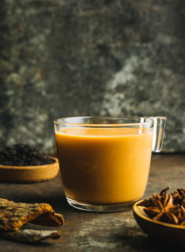 Chai tea latte on rustic background