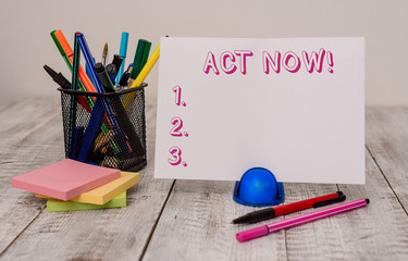 Writing note showing Act Now. Business concept for do not hesitate and start working or doing stuff right away Stationary and computer mouse with globe on the wooden desk