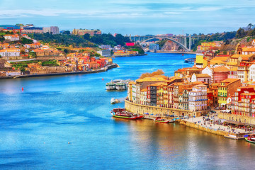 Canvas Prints Pool Porto, Portugal old town ribeira aerial promenade view with colorful houses, Douro river and boats