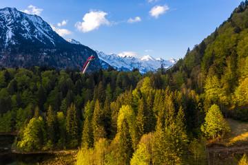 Blick vom Freibergsee zur Skiflugschanze im Stillachtal im Allgäu / View from Freibergsee Lake towards ski jump skier and Stillachtal valley near Oberstdorf ins Bavaria