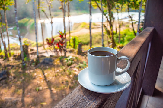 Coffee with a view, at background the turquoise waterfalls at Las Nubes in Chiapas, Mexico