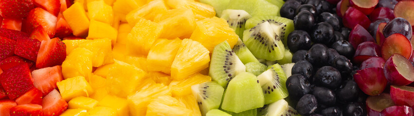 A Background of Rainbow Colored Fruit Salad