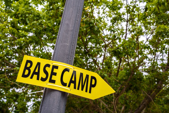 Poster with the word yellow Basecamp with arrow to indicate the location.