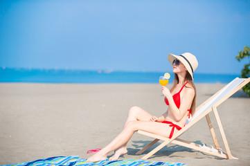 woman sunbathing with juice