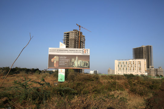 Billboard stands in front of buildings under construction at the GIFT City at Gandhinagar