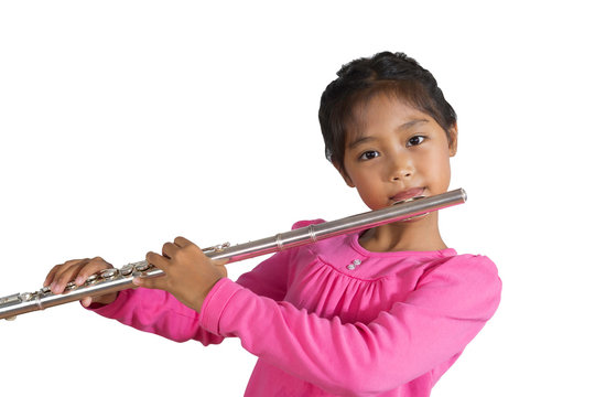 The isolated image of a girl wearing a pink long-sleeved shirt is playing flute.