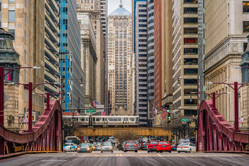 Photo sur Toile Chicago Scene of Chicago street bridge with traffic among modern buildings of Downtown Chicago at Michigan avenue in Chicago, Illinois, United States, Business and Modern Transportation concept