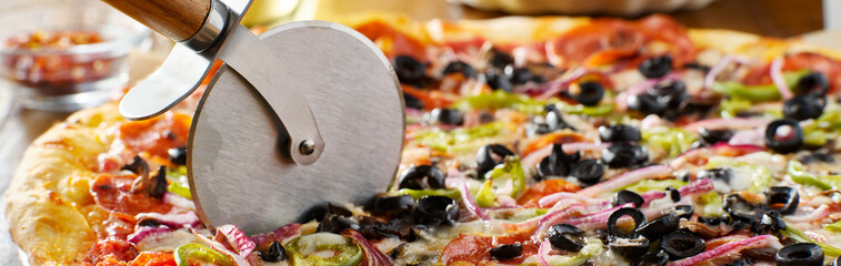 tasty supreme pizza with olives peppers onions and sausage panorama