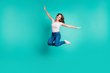 Wall Mural - Full length body size view of her she nice-looking attractive lovely winsome cheerful cheery wavy-haired lady having fun like plane wings isolated on bright vivid shine blue background