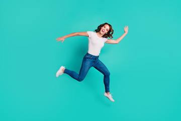 Wall Mural - Full length body size view of her she nice attractive lovely crazy careless carefree cheerful slim fit thin slender wavy-haired lady having fun holiday isolated on bright vivid shine blue background