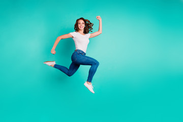 Wall Mural - Full length body size view of her she nice attractive lovely cheerful cheery strong sportive slim fit thin slender wavy-haired lady rush hour black friday isolated on bright vivid shine blue