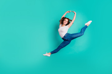 Wall Mural - Full length body size view of her she nice-looking attractive lovely cheerful cheery sportive slim fit thin slender wavy-haired lady practicing hobby isolated on bright vivid shine blue background