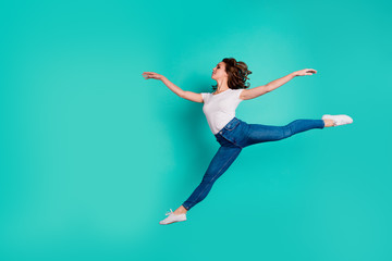 Wall Mural - Full length body size view of her she nice attractive lovely graceful feminine sportive slim fit thin adorable wavy-haired lady practicing modern moves isolated on bright vivid shine blue background