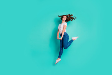 Wall Mural - Full length body size view of her she nice attractive lovely sportive slim fit slender cheerful cheery glad wavy-haired lady having fun isolated on bright vivid shine blue background