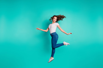Wall Mural - Full length body size view of her she nice attractive lovely feminine sweet sporty slim fit thin slender cheerful wavy-haired lady strolling isolated on bright vivid shine blue background