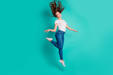 Wall Mural - Full length body size view of her she nice-looking attractive lovely winsome sweet slim fit thin cheerful wavy-haired lady strolling having fun pleasure isolated on bright vivid shine blue background