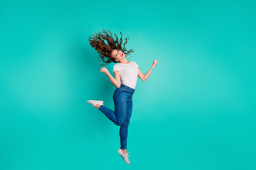 Wall Mural - Full length body size view of nice attractive lovely winsome slim fit thin cheerful cheery wavy-haired lady having fun rejoice satisfaction isolated on bright vivid shine blue background