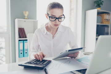 Close up photo beautiful she her business lady count freelance salary calculating income investment hold watch compare data hands arms e-reader notebook table wear specs formal-wear bright office