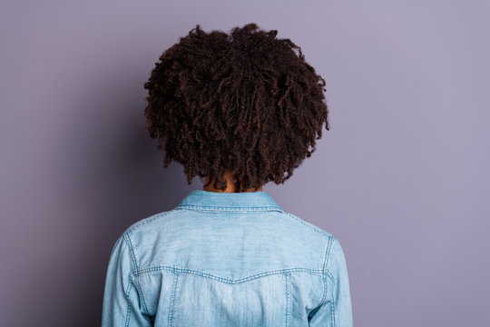 Close up back rear behind view photo of cool smart successful millennial stand behind show shoulders feel glad content relaxed dressed denim fashionable clothes isolated grey background