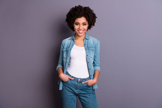 Portrait of pretty cute charming lady youth excited enjoy free time true expert leader leadership put hands palms pockets denim trousers isolated grey background