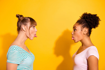 Porfile side view photo funny cute attractive teen teenager childish carefree rest fool make faces way curly hairdo style stylish trendy shadow top-knot summer modern outfit isolated yellow background