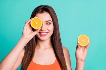 Fototapeta Close up photo beautiful amazing her she lady hold arms hide one eye citrus useful slices products advertising nutrition freshness wear casual orange tank-top isolated bright teal turquoise background obraz