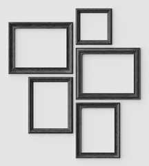 Black wood picture or photo frames on white wall with shadows