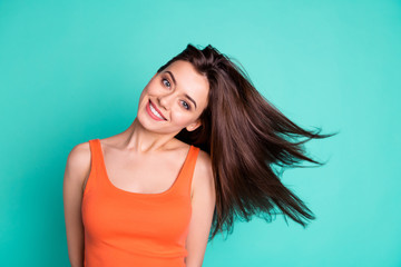 Close up photo amazing beautiful her she lady weekend vacation wind blowing hair flight healthy condition new shampoo advice wear casual orange tank-top isolated bright teal turquoise background Wall mural