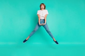 Wall Mural - Full length body size photo beautiful she her lady carefree childish weekend vacation jump high arms hands together achievement wear casual jeans denim white t-shirt isolated teal background