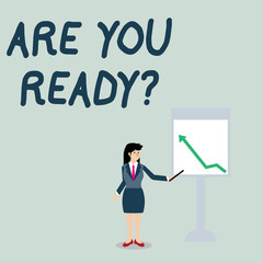 Conceptual hand writing showing Are You Ready Question. Concept meaning used telling someone start something when feel prepared Woman Holding Stick Pointing to Chart of Arrow on Whiteboard