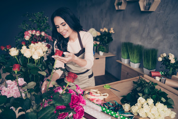 Portrait of her she nice-looking charming attractive winsome cheerful wavy-haired assistant businesslady girlfriend grooming garden fashion love hobby industrial loft interior concrete wall workplace
