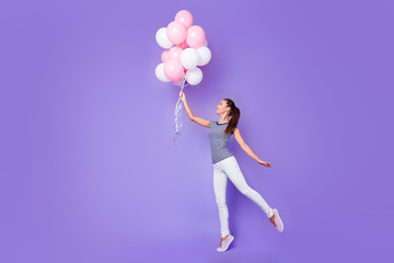 Full length body size view portrait of her she nice-looking attractive lovely charming cheerful cheery girl dancing with helium balls isolated over violet purple vivid shine bright background