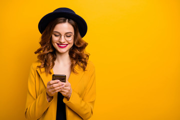 Close up photo beautiful she her toothy lady arms hands telephone check instagram followers perfect red lips pomade wear specs formal-wear costume suit isolated yellow vivid vibrant background