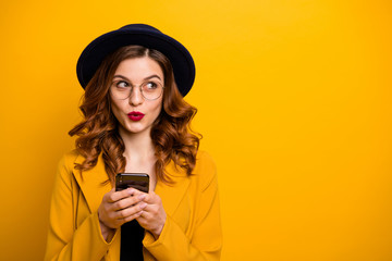Close up photo beautiful she her lady watch sly tricky side empty space arms hands telephone reader cool news modern look wear specs formal-wear costume suit isolated yellow vibrant background
