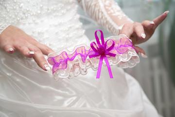 bride shows her wedding garter. fashion and beauty women.