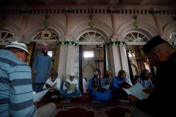 Nepalese Muslims read Koran during the Muslim holy month of Ramadan in Kathmandu