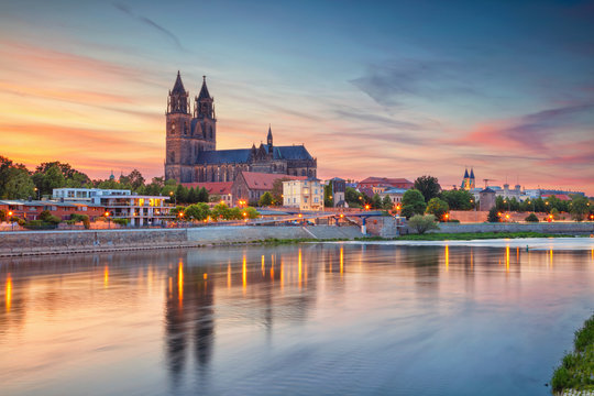 Magdeburg, Germany. Cityscape image of Magdeburg, Germany with reflection of the city in the Elbe river, during sunset.