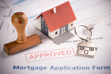 Fototapeta  An approved Mortgage loan application form with house key and rubber stamp