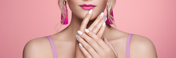 Obraz Beauty Woman with perfect Makeup and Manicure. Glamour Girl with Jewelry. Pink Lips and Nails. Precious Stones and Silver. Beauty girls Face isolated on light Background. Fashion photo - fototapety do salonu
