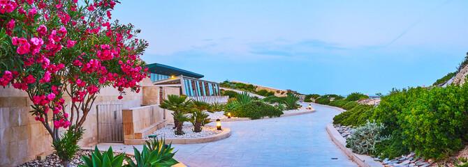 Tigne Point coastal garden in the evening, Sliema, Malta