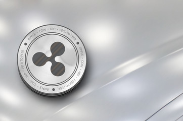 Ripple (XRP) digital crypto currency. Silver coin. Cyber money.