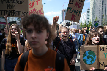 School pupils protest as they join a world-wide school strike aiming for action on climate change in Warsaw