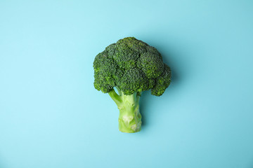Fresh green broccoli on color background, top view. Organic food Wall mural