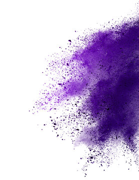 Freeze motion of purple color powder exploding on white background.
