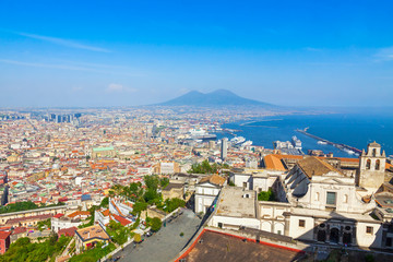 Panoramic aerial view of Napoli city with famous Mount Vesuvius and Gulf of Naples on the background, Campania region, Italy